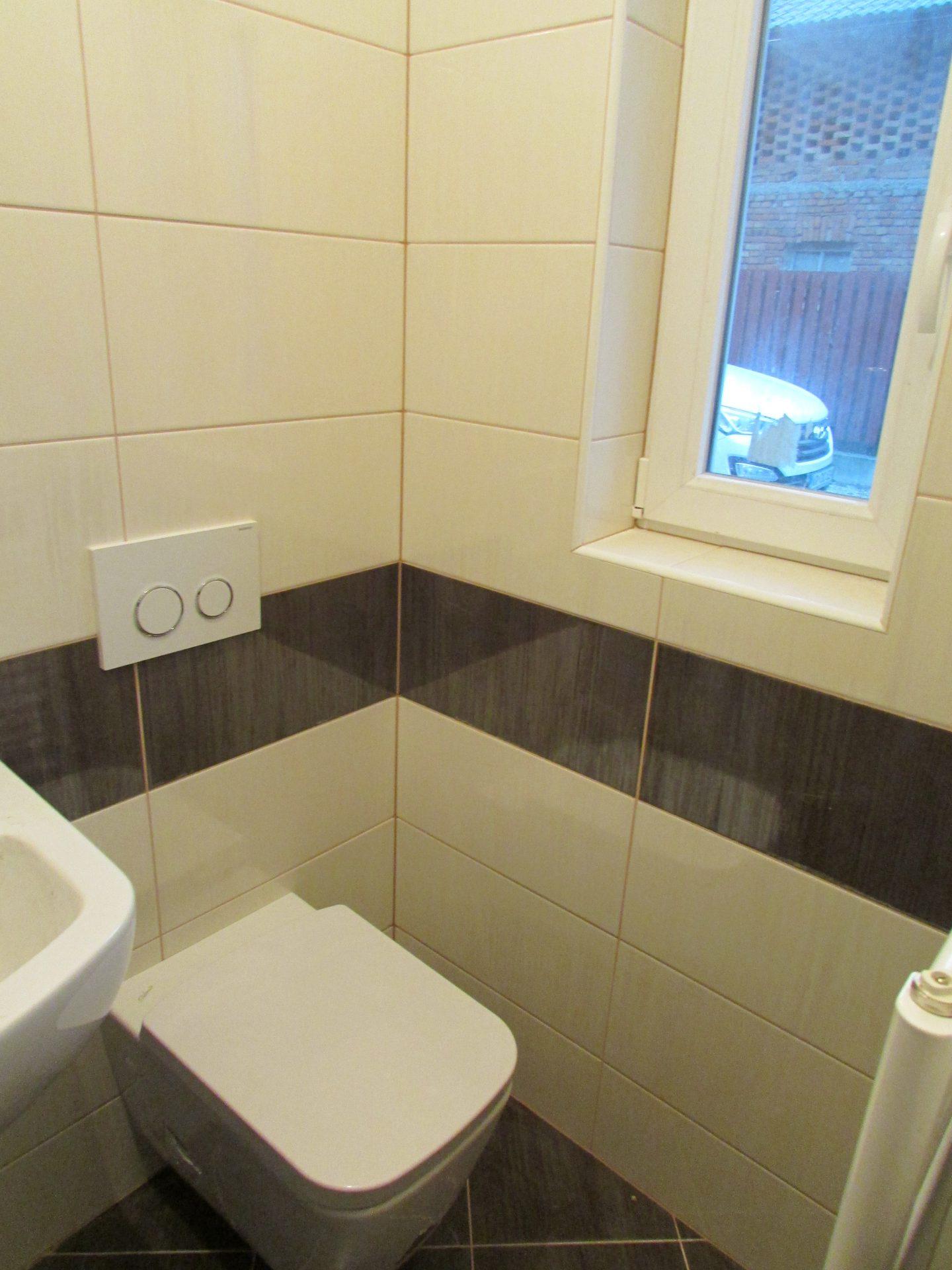 Polaganje ploščic v kopalnici 17